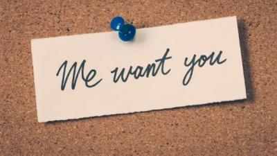 we want you handwritten sign pinned to corkboard